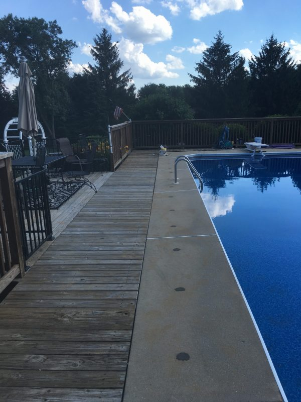 concrete pool deck raised to meet wood decking