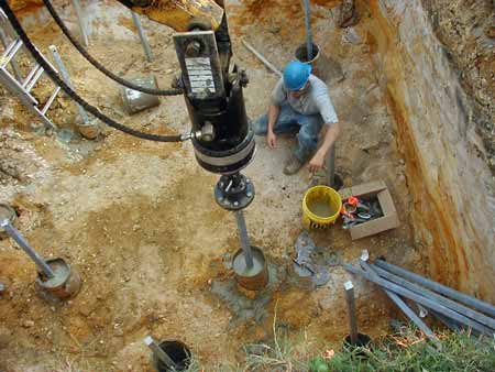 drilling during installation of helical piers